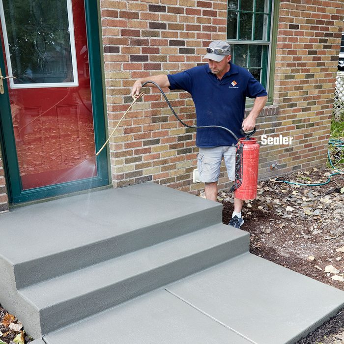 Man sealing a step with Concrete Sealer | Construction Pro Tips