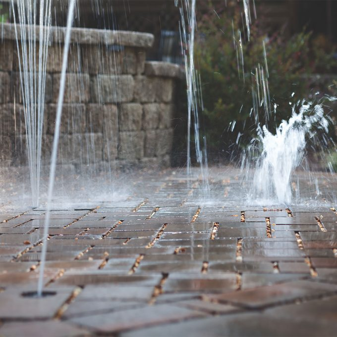 Water shooting up between cracks in the pavers | Construction Pro Tips