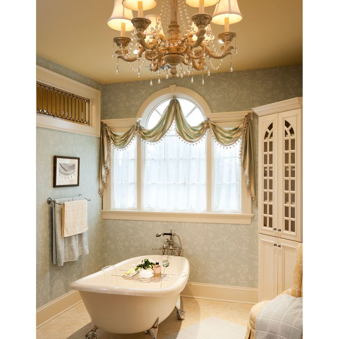 Warm traditional styled master bath with clawfoot Gettyimages 155385265
