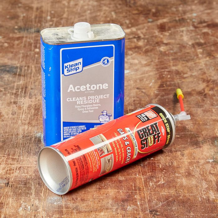 Cans of acetone and spray foam on a table | Construction Pro Tips
