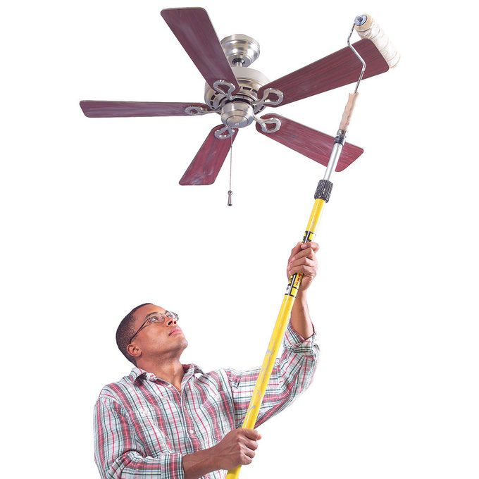 Dusting a ceiling fan with a paint roller | Construction Pro Tips