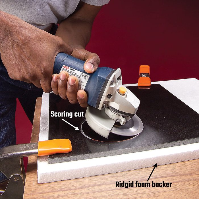 Starting circular cuts in tile by scoring the surface   Construction Pro Tips