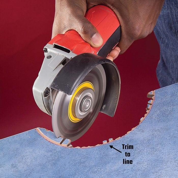 Making radial cuts into a semi-circular cut tile   Construction Pro Tips
