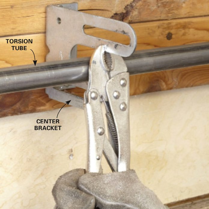 Using locking pliers on garage door