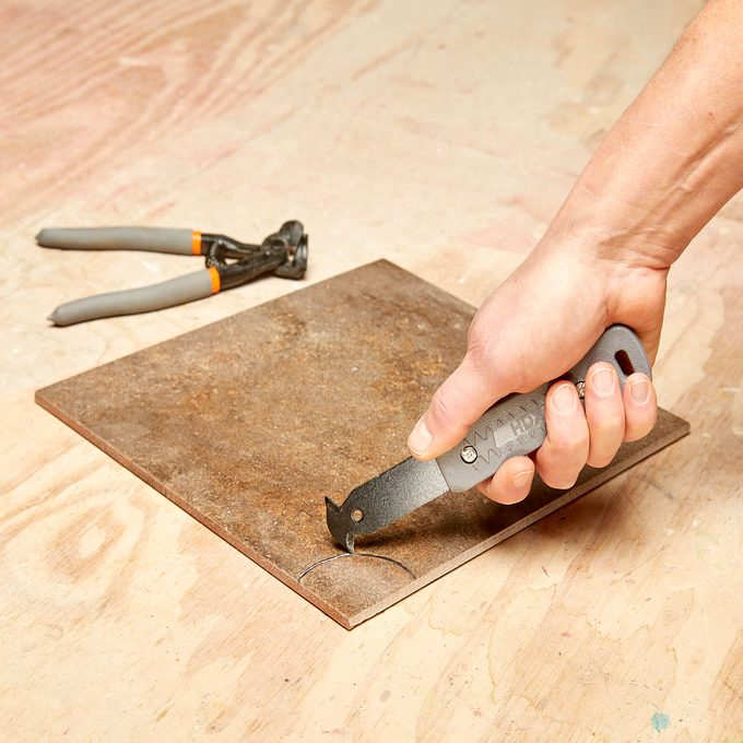 Cutting a groove in tile   Construction Pro Tips