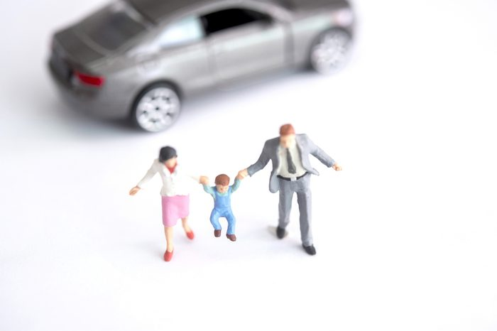miniature figure of family on white background