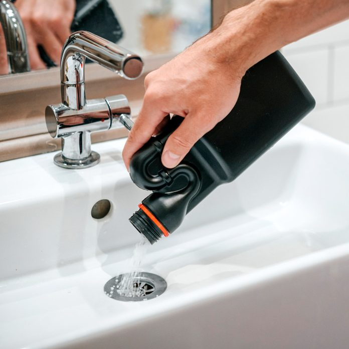 drain cleaner going into drain