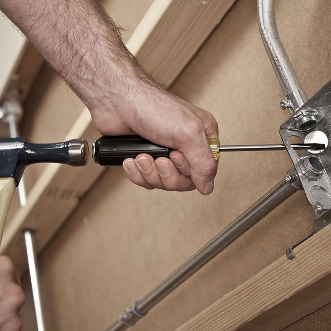 Striking the back of a demo screw driver   Construction Pro Tips