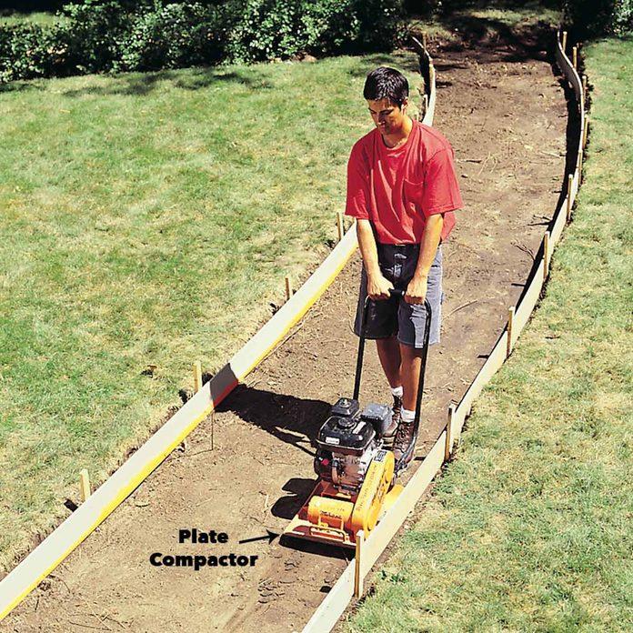 Pack the soil concrete sidewalk