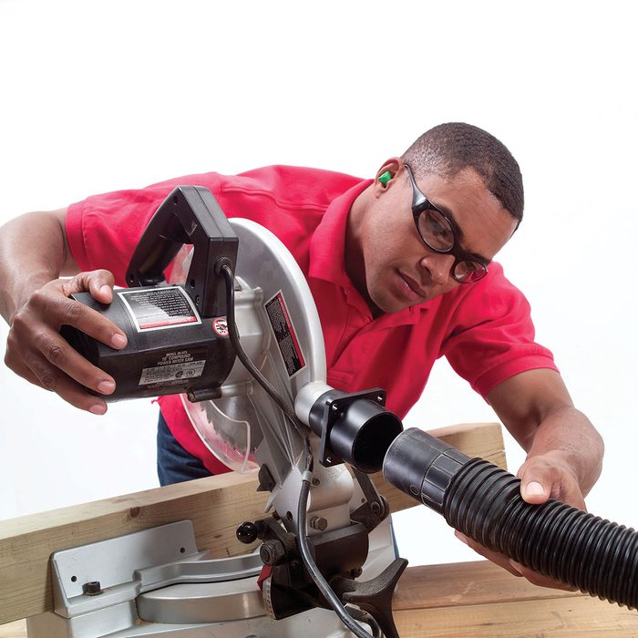 Attaching a hose to the back of a miter saw | Construction Pro Tips