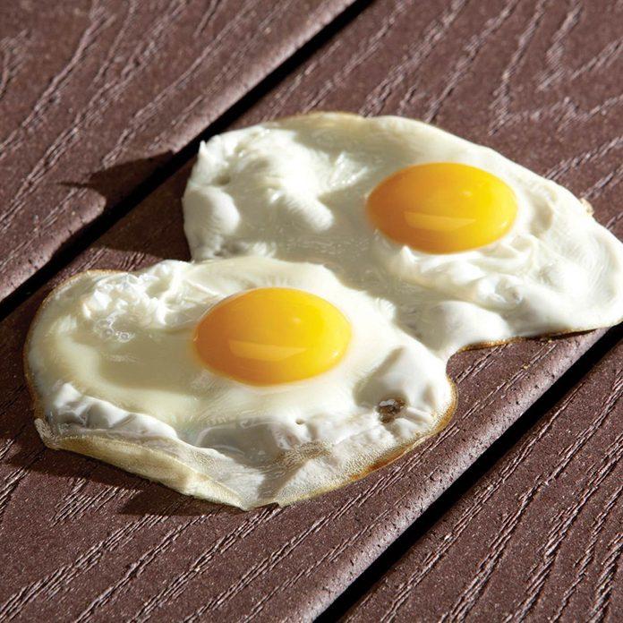 fried egg on dark composite deck