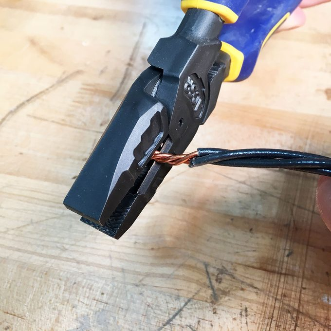Clipping wires with linesmans pliers   Construction Pro Tips