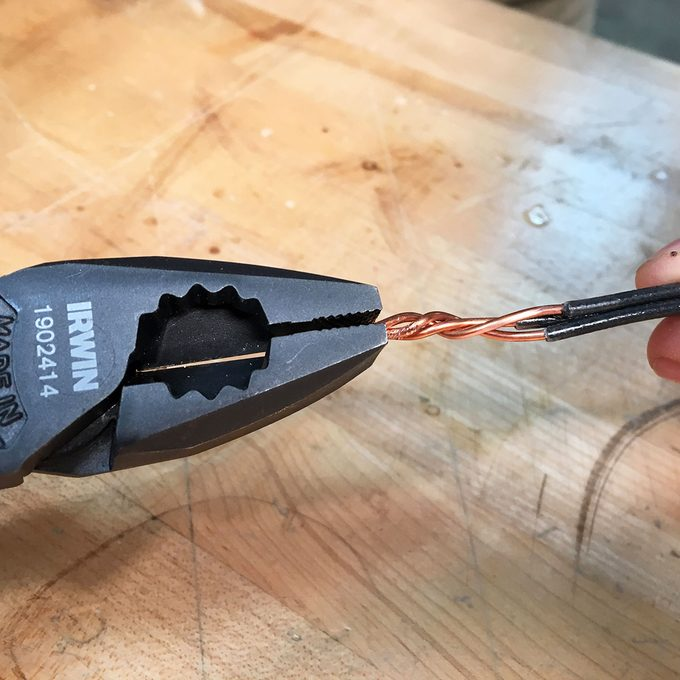 Twisting wires with a linesman's pliers   Construction Pro Tips