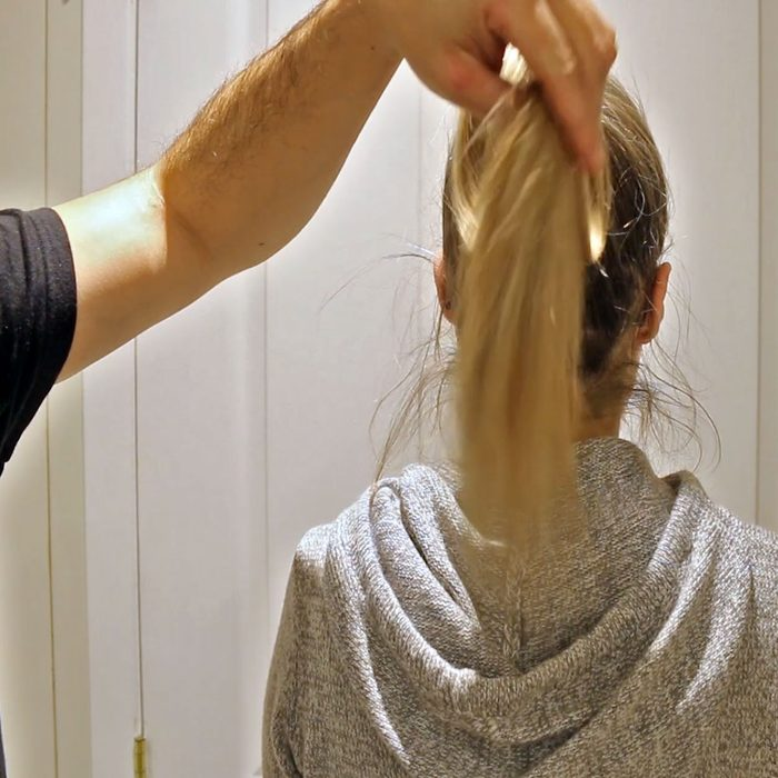 Man holding the back of a pony tail | Construction Pro Tips