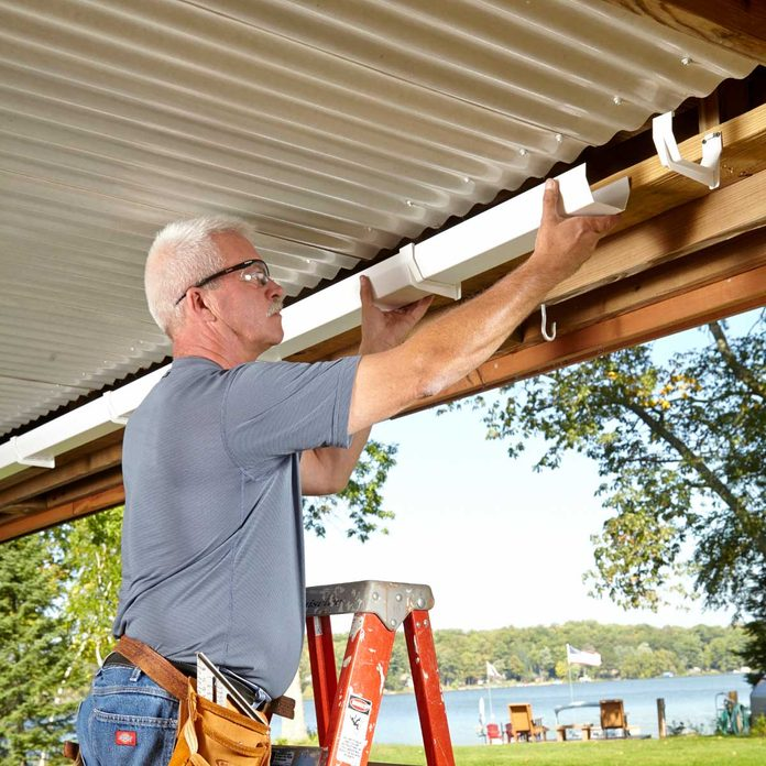 under deck roof install gutters and downspouts