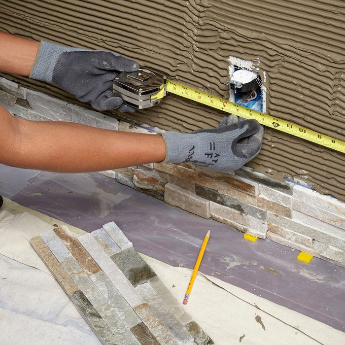 Measuring for an outlet opening | Construction Pro Tips