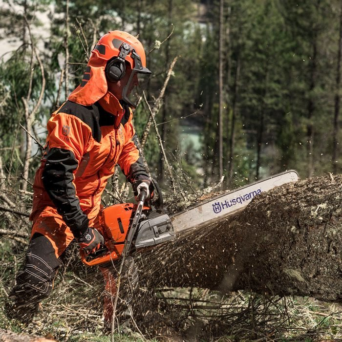 Cutting into a fallen tree with a Husqvarna chainsaw   Construction Pro Tips