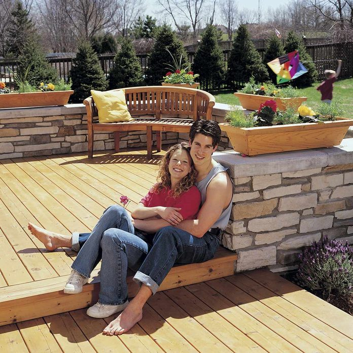 deck with stone wall