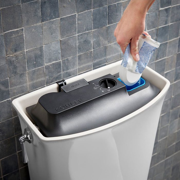 Kohler cleaning being dumped into toilet | Construction Pro Tips