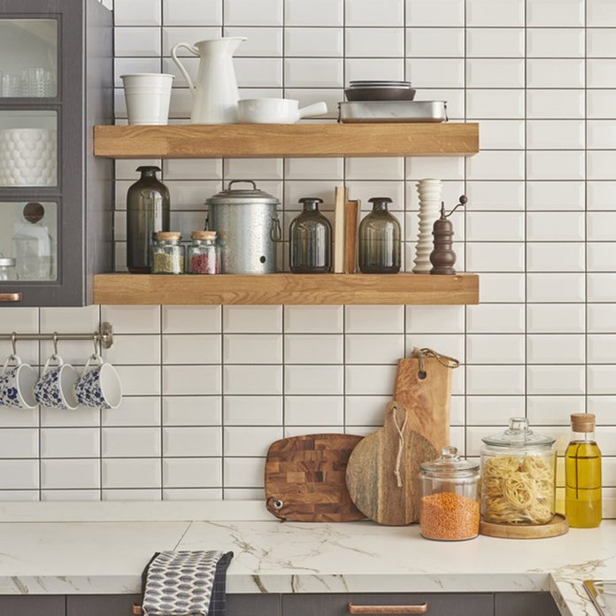 A collection of different ceramics complement a patterned tiles.