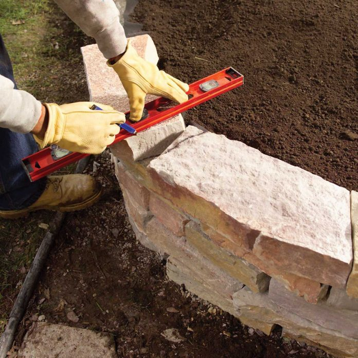 Level the last course and dry-fit the capstones