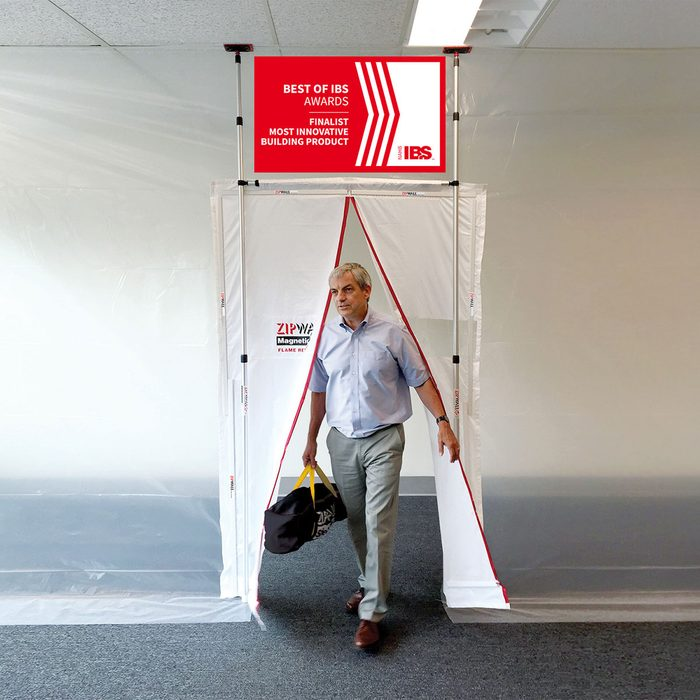 Man walking through opening in plastic barrier | Construction Pro Tips