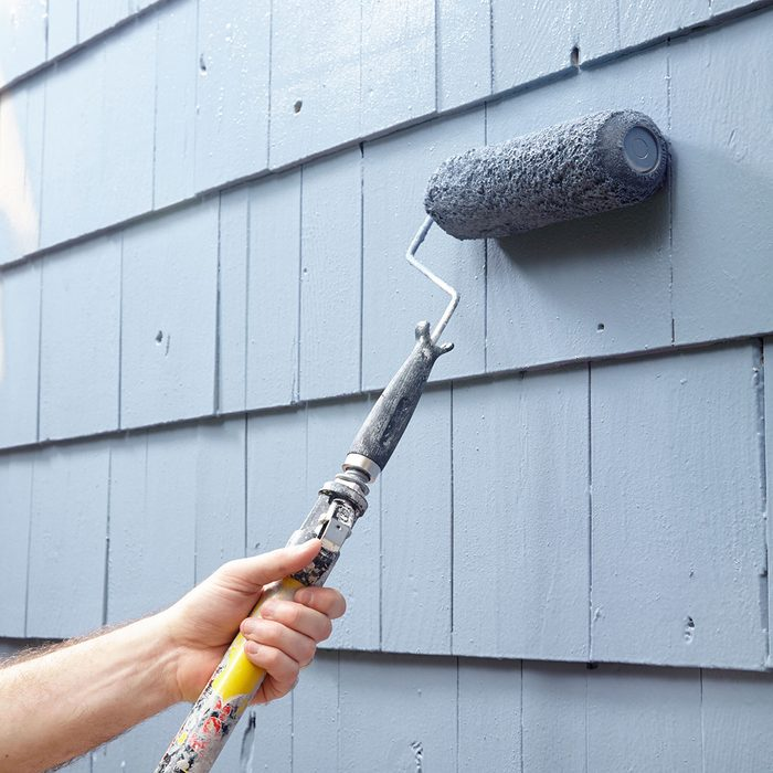 Rolling paint on to siding | Construction Pro Tips