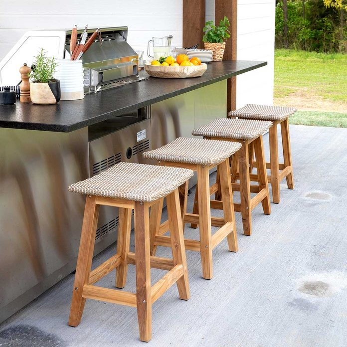 outdoor kitchen with stools
