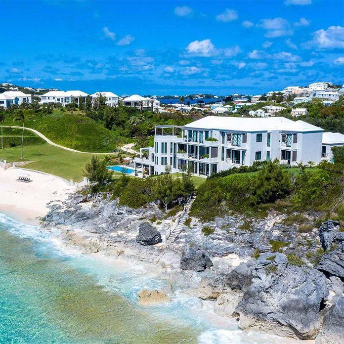 Oceanside mansion near a rocky ridge