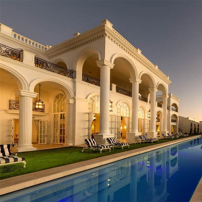 Mansion with a pool in front in South Africa