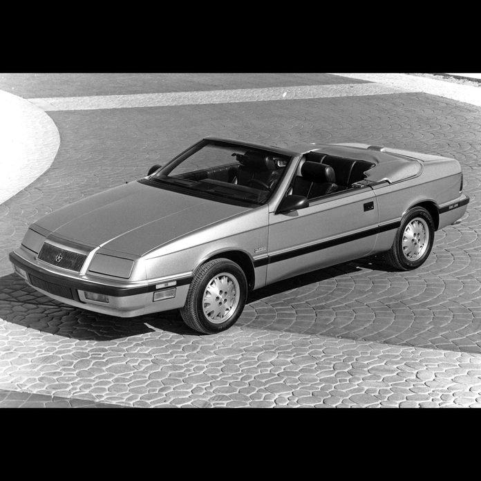 1987 Chrysler LeBaron convertible parked on a brick driveway