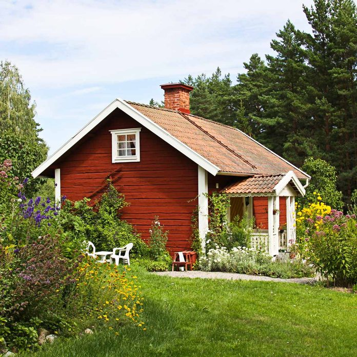 Beautiful summer cottage with flower in the garden