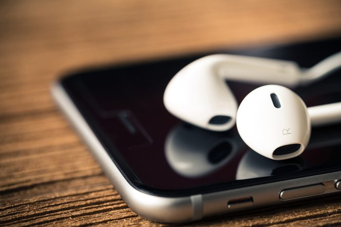 close up modern earphone on mobile phone : vintage style