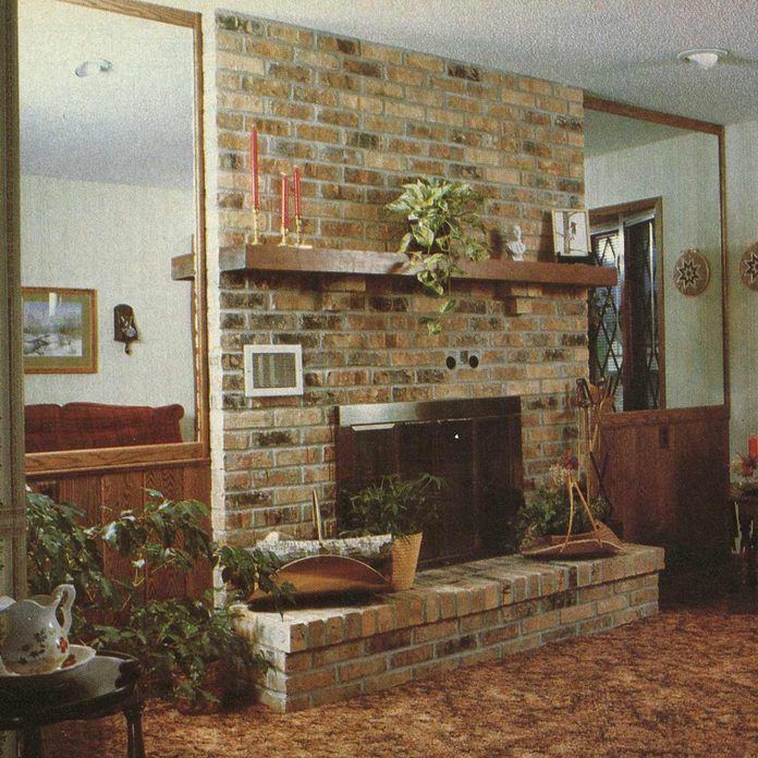 1982 living room with brown carpet and fireplace