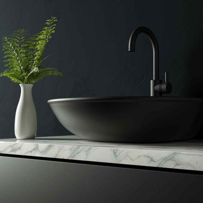 Black-bathroom-with-marble-and-water-faucet