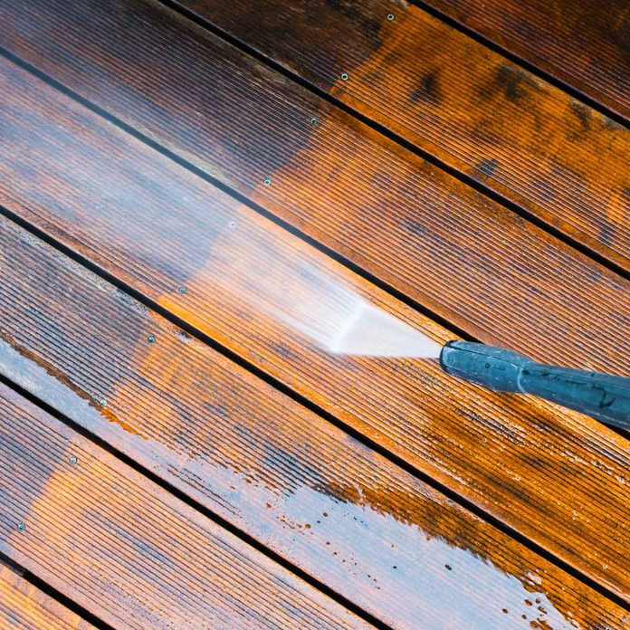 Pressure-washing-a-deck
