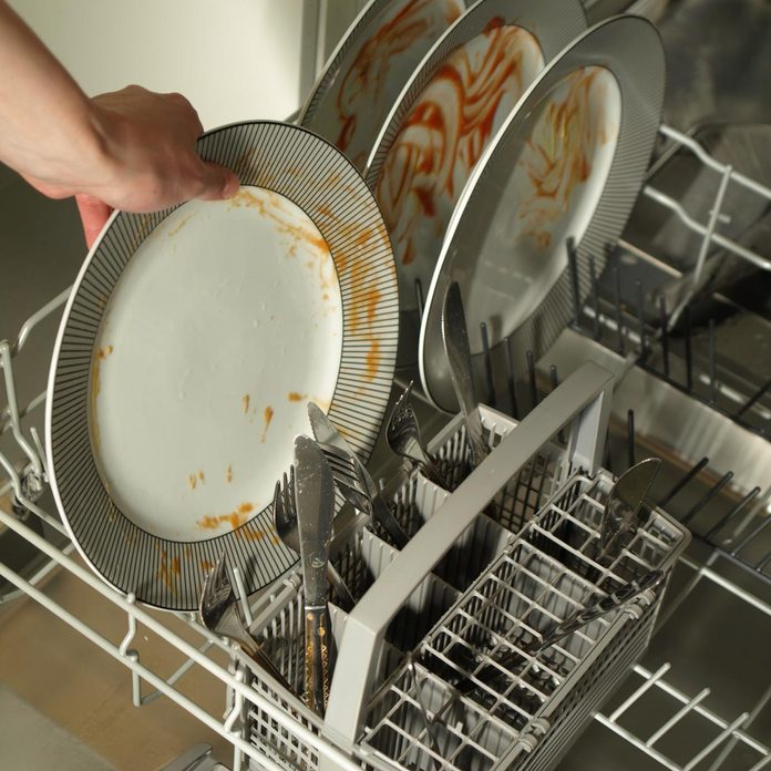 Putting-dirty-plates-in-the-dishwasher