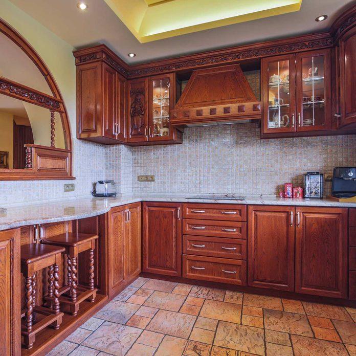 Kitchen-with-dark-cabinets-and-gravel-colored-backsplash