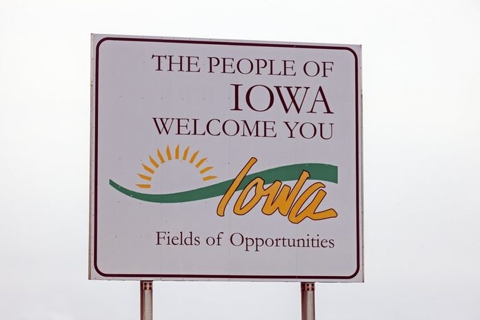 Welcome to Iowa sign seen against the clouds. Iowa, USA.