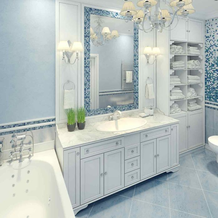 Bright-art-deco-bathroom-interior-The-spacious-bathroom-with-white-furniture-and-fragments-of-mosaic-wall