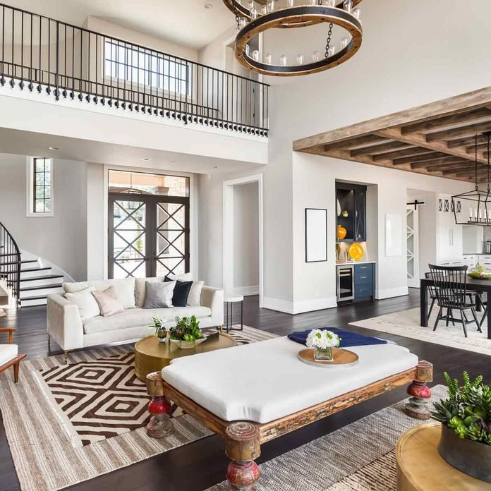Stunning-Panorama-of-Luxury-Home-Interior-with-Open-Concept-Floor-Plan-Shows-Living-Room-Dining-Room-Kitchen-and-Entry.-Elegant-Stairs-Lead-up-to-Second-Story