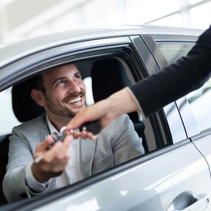 Portrait-of-happy-customer-buying-new-car