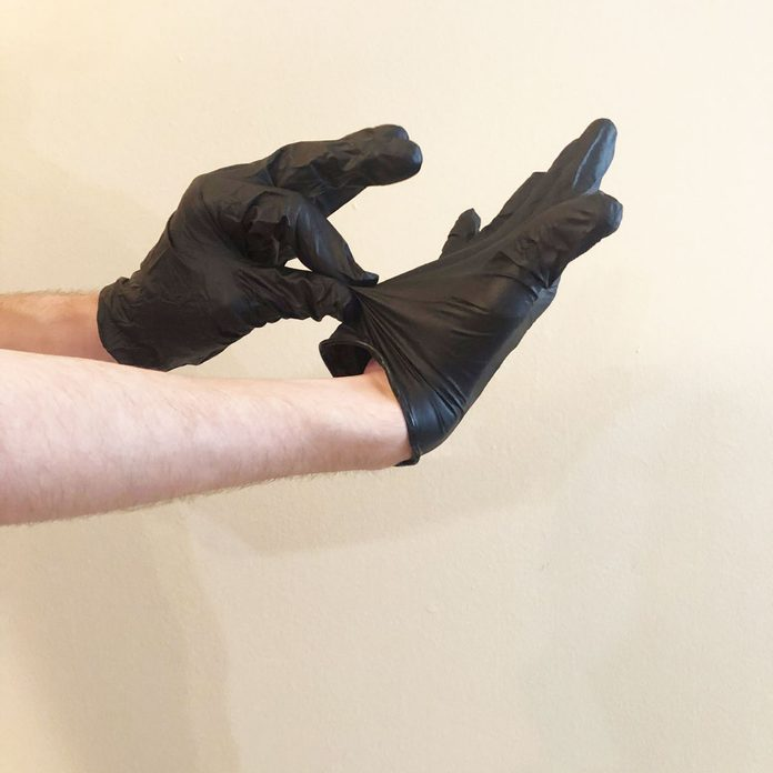Step 1 of removing nitrile gloves