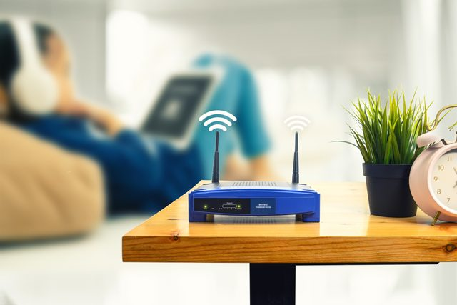Close-Up Of Wireless Router On Table At Home