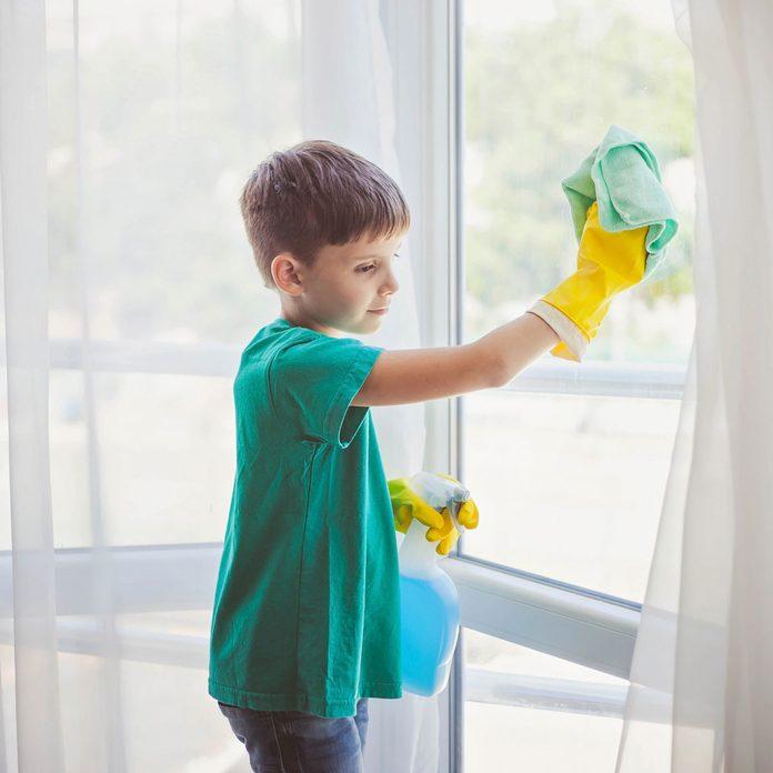 Boy cleaning windows