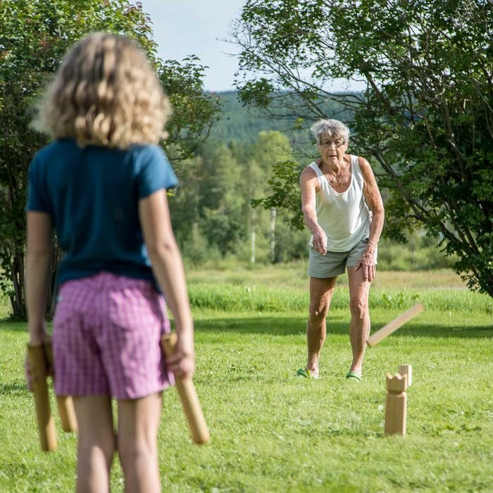Grandmother and granddaughter playing Kubb