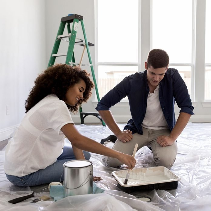 Couple painting their home