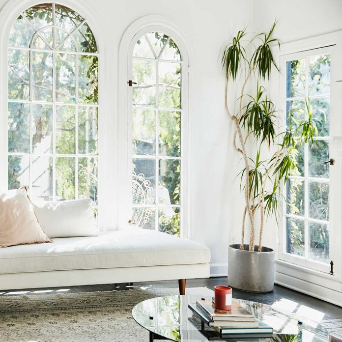 Room with white walls, trim and seating