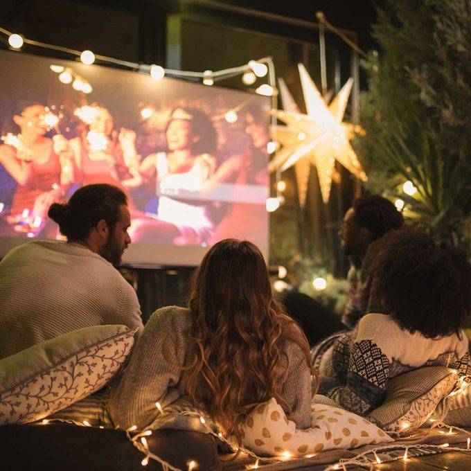 Outdoor projector with four people