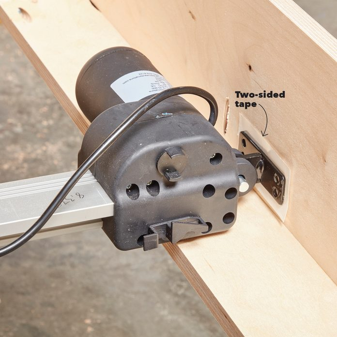 Using tape to position the mounting bracket